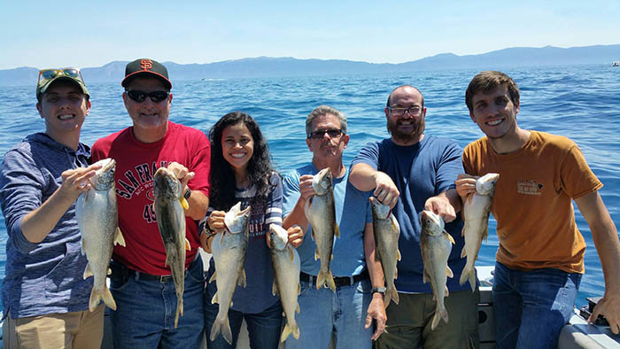 Group of people fishing with Mile High Fishing Charters